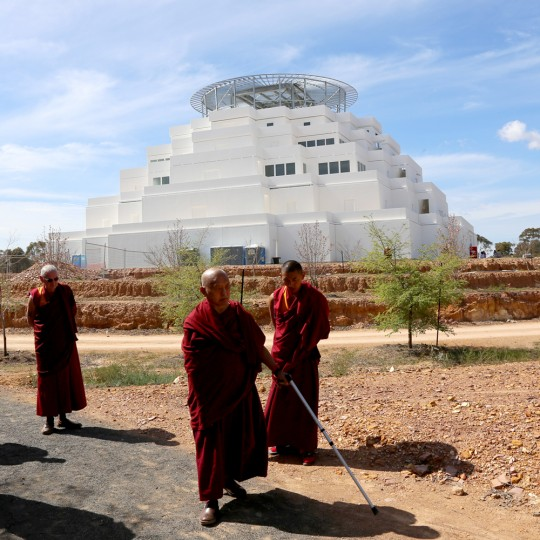 Lama Zopa Rinpoche being led on a tour of the Great Stupa of Universal Compassion by Ian Green, Australia, September 20, 2014. Photo by Tom Truty.