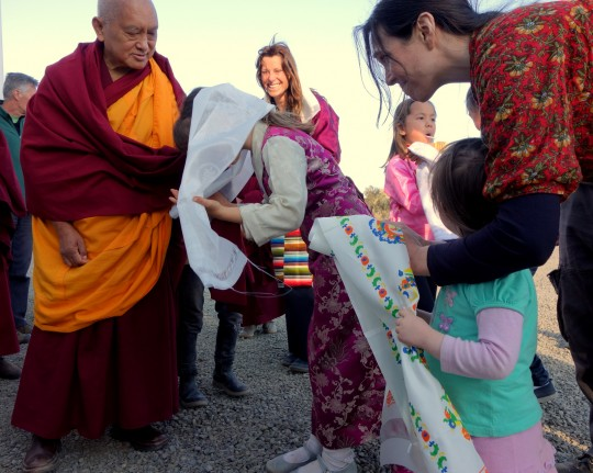 Lama Zopa Rinpoche giving blessing to children after the long life puja, Great Stupa of Universal Compassion, Australia, September 19,  2014. Photo by Ven. Roger Kunsang.