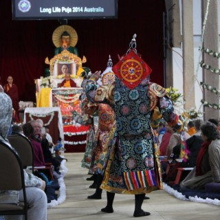 Five dakini dancers entering the gompa, Great Stupa of Universal Compassion, Australia, September 19, 2014. Photo by Laura Miller.
