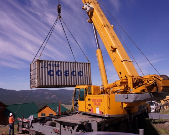 A crane lifts the container that holds the Amitabha Buddha statue, Buddha Amitabha Pure Land, Washington, US, July 1, 2014. Photo by Merry Colony.