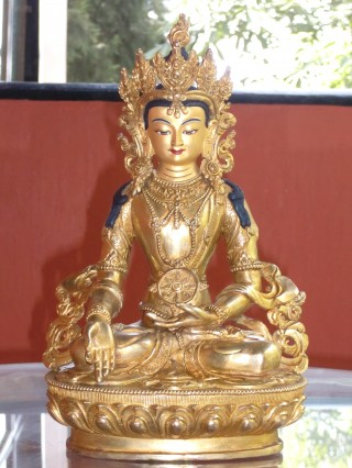 This statue is being consulted as a prototype for the Five Dhayani Buddhas being created.