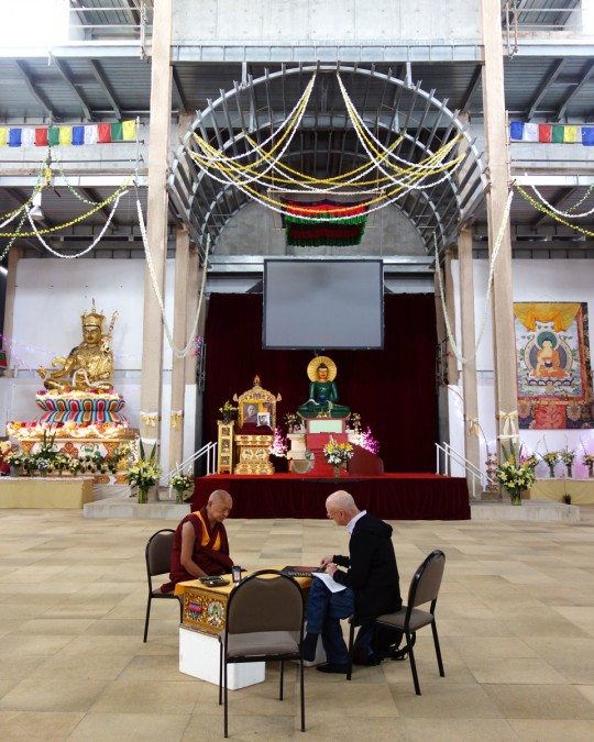 Lama Zopa Rinpoche and Ian Green discussing the art and decorations for the Great Stupa of Universal Compassion interior, Bendigo, Australia, October 2014. Photo by Ven. Roger Kunsang.