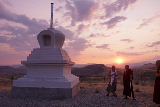 Lama Zopa Rinpoche visiting the stupa under construction at Pamtingpa Center, Washington.