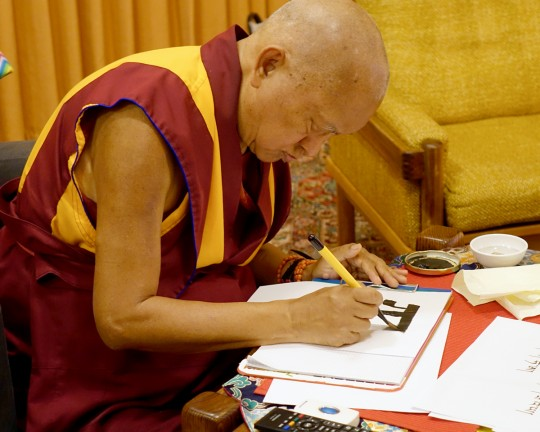 Lama Zopa Rinpoche writing out the Tibetan alphabet, Thubten Shedrup Ling Monastery, Australia, October 2014. Photo by Ven. Roger Kunsang.