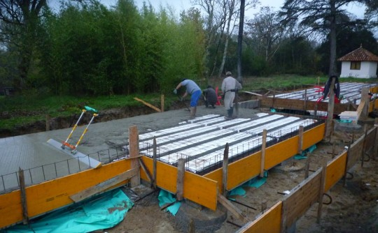 Pouring concrete, Nalanda Monastery, Labastide St. Georges, November 2012. Photo by Martijn Prins.