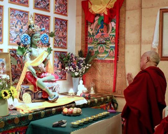 Lama Zopa Rinpoche blessing the Green Tara statue in Atisha Centre's gompa, Bendigo, Australia, September 2014. Photo by Ven. Thubten Kunsang.
