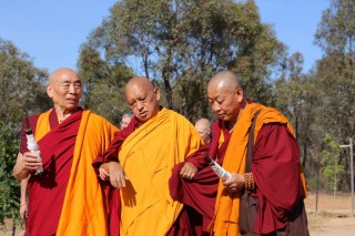 Lama Zopa Rinpoche being led into the long life puja.