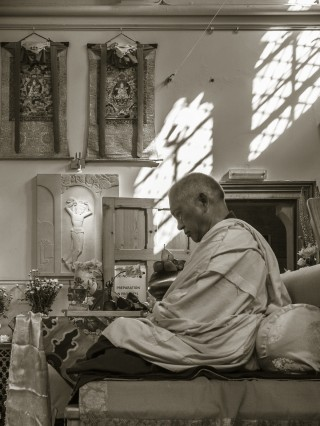Lama Zopa Rinpoche preparing to teach at Jamyang Buddhist Centre, London, UK, July 2014. Photo by Pierre Aloize.