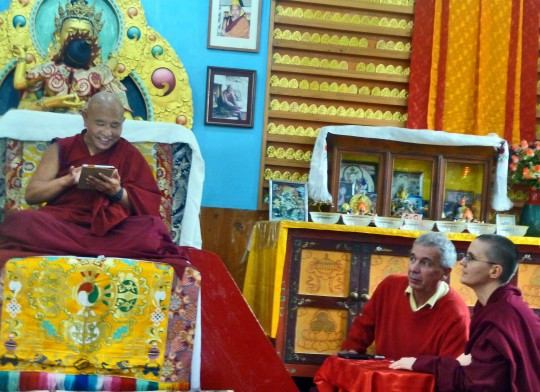 Jhado Rinpoche explores a tablet computer with Andy Wistreich and Geshe Kelsang Wangmo ready to assit, Dharamsala, India, July 2014. Photo courtesy of Tushita Meditation Centre.