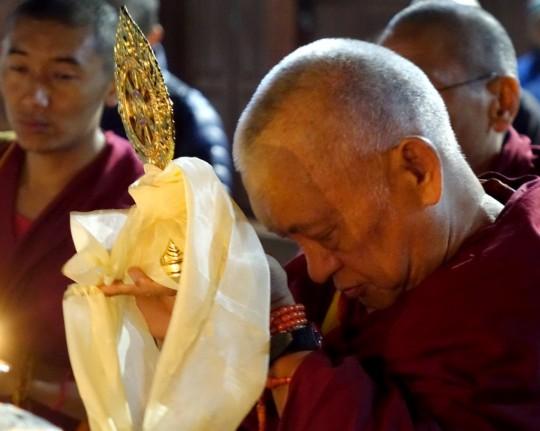 Lama Zopa Rinpoche offering Dharmachakra at Boudhanath Stupa, Nepal, December 2014. Photo by Ven. Roger Kunsang.