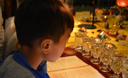 Child visitor at Maitreya Loving Kindness Tour relic exhibition in Toronto, Canada, 2014. Photo by Thupten Wangyal.