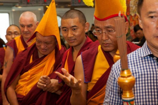 Lama Zopa Rinpoche being led into the long life puja offered by Amitabha Buddhist Centre in Singapore, November 23, 2014.