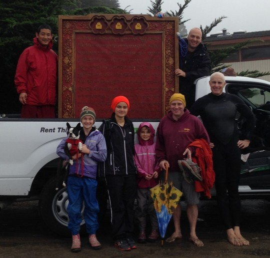 Sangha and students rented a truck and transported a large Namgyalma mantra board to bless beings in the ocean. Photo by Troy Stafford.