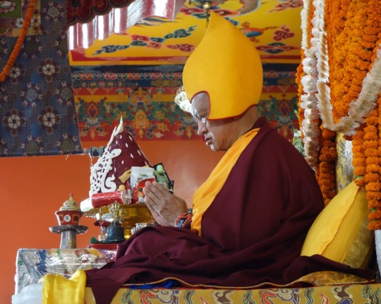 Lama Zopa Rinpoche teaching at Kopan Monastery, Nepal, December 2014. Photo by Ven. Roger Kunsang.
