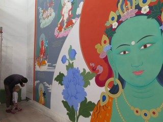 21 Taras thangka is 14 meters (46 feet) high and 9 meters (30 feet) wide. This thangkha is being painted by artist Peter Iseli at a workshop at Institut Vajra Yogini, France.