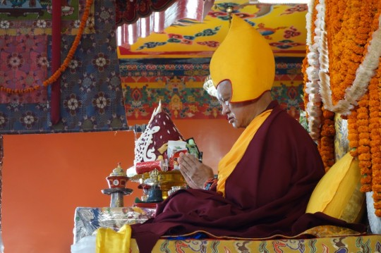 Lama Zopa Rinpoche reciting the names of the 35 Buddhas during a long life puja at Kopan Monastery, Nepal, December 2104. Photo by Ven. Roger Kunsang.
