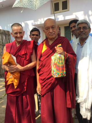 Lama Zopa Rinpoche holds a bag filled used to bless the chickens at Root Institute, Bodhgaya, India, March 2015. Photo by Ven. Sarah Thresher.