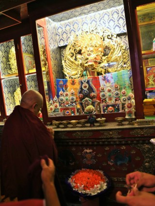 Lama Zopa Rinpoche showing respect to a Hayagriva statue on the altar at Idgaa Choizinling College in Mongolia.