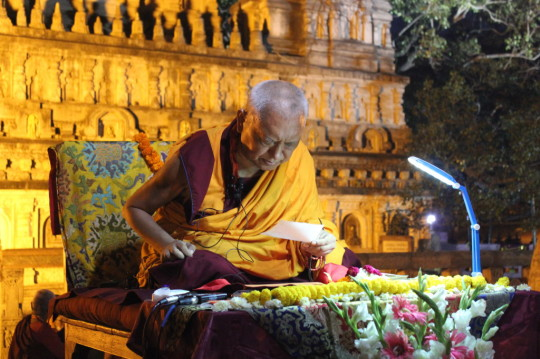 Lama Zopa Rinpoche giving the oral transmission of the Vajra Cutter Sutra at the Mahabodhi Stupa, Bodhgaya, India, March 2015. Photo by Ven. Lobsang Sherab.