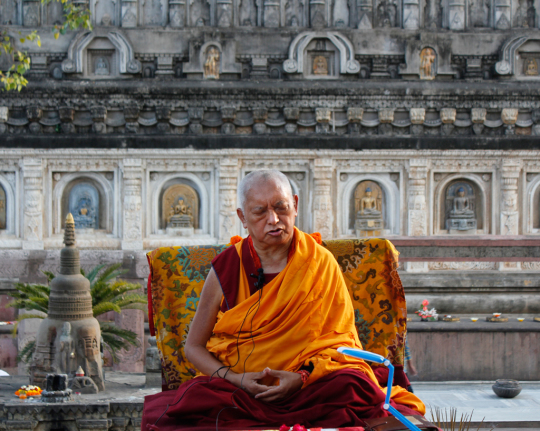 Lama Zopa Rinpoche giving the oral transmission of the Vajra Cutter Sutra at the Mahabodhi Temple, Bodhgaya, India, March 2015. Photo by Ven. Losang Sherab.