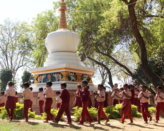 Students circumambulatingthestupaatMaitreyaSchool, Root Institute, Bodhgaya, India, March 2015. Photo by Ven. Roger Kunsang.