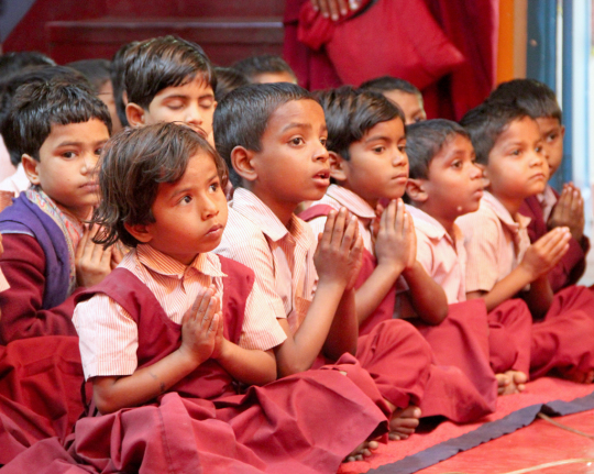 Students of Maitreya School listening to Lama Zopa Rinpoche, Root Institute, Bodhgaya, India, March 2015. Photo by Ven. Roger Kunsang.