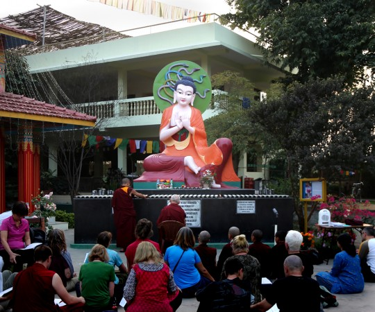 Lama Zopa Rinpoche in front of Nagarjuna statue at Root Institute, Bodhgaya, India, February 2015.