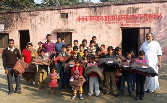 During the winter 2014 months, Maitreya Buddha Kunshinagar Project distributed thick blankets to various institutions, including orphanges, India, 2014. Photo courtesy of Maitreya Buddha Kushinagar Project.