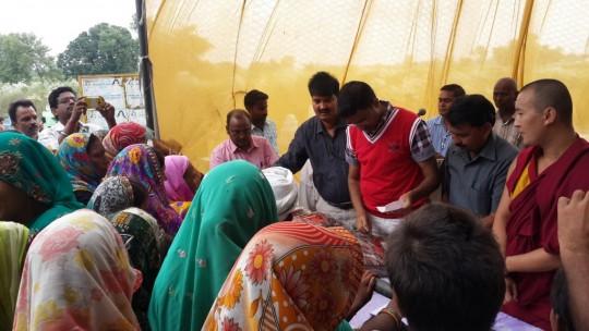 Maitreya Buddha Kushinagar Project workers distribute mosquito nets, India, 2014. Photo courtesy of Maitreya Buddha Kushinagar Project.