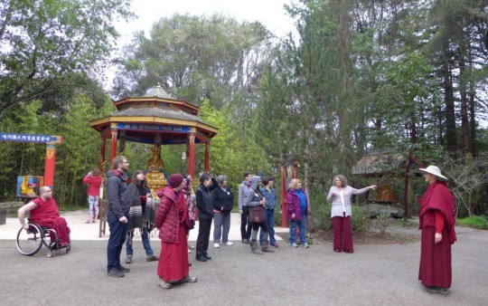 Kshitigarba statue and Foundation Service Seminar participants at Land of Medicine Buddha, California, January 2015. Photo by Laura Miller.