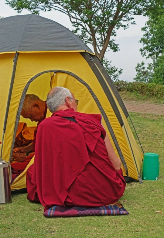 Lama Zopa Rinpoche and Ven. Roger Kunsang in the enlightenment garden at Kopan Monastery, where they have been camped out, Nepal, April 2015. Photo by Ueli Minder.