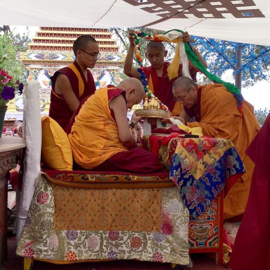 Lama Zopa Rinpoche accepting body, speech and mind mandala offering from Khen Rinpoche Geshe Chonyi, abbot of Kopan, April 27, 2015. Photo by Ven. Sarah Thresher.