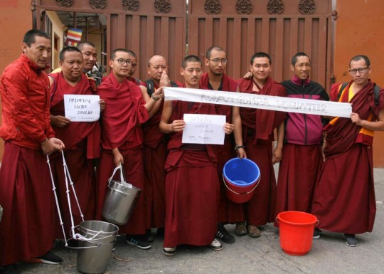 Kopan monks ready to distribute water, Kathmandu, Nepal, April 29, 2015. Photo by Phil Hunt.