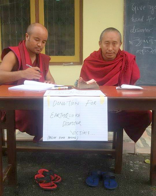 Monks receiving donations at Kopan Monastery, Nepal, April 29, 2015