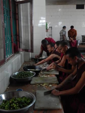Day 5: Kopan Monastery monks and stuff help prepare food aid for earthquake victims, Kopan,  Nepal, April 2015. Photo via Facbook, Kopan Monastery School.