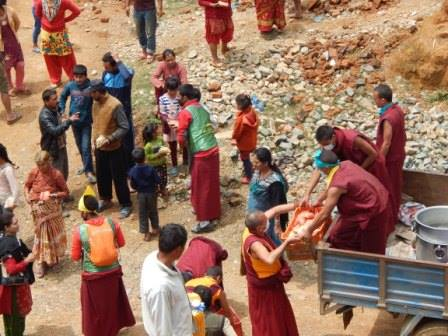 Kopan Monastery monks distribute food aid packages to earthquake-affected villages, Nepal, April 2015.