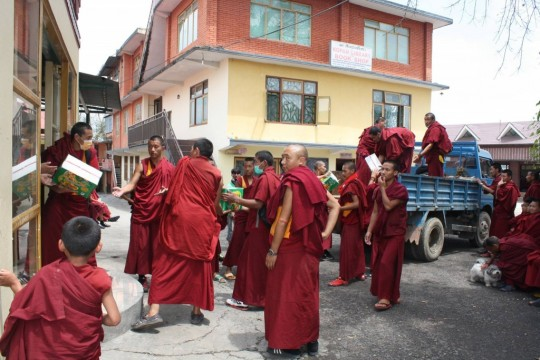 Kopan monks loading supplies on to truck for distribution, Kopan Monastery, Nepal, April 30, 2015. Photo courtesy of Kopan Apso Facebook page.