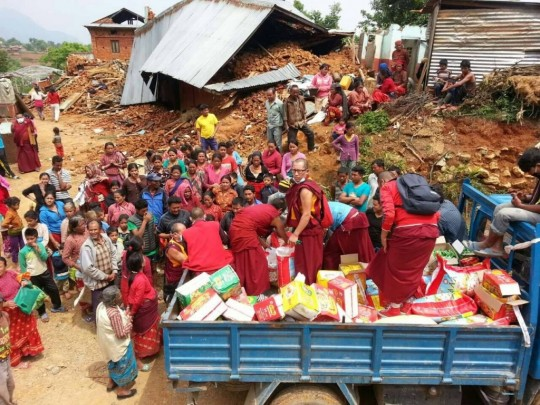 Kopan monks distribute aid to villagers after earthquake, Nepal, May 1, 2015. Photo via Ven. Nawang Thinley's Facebook page.