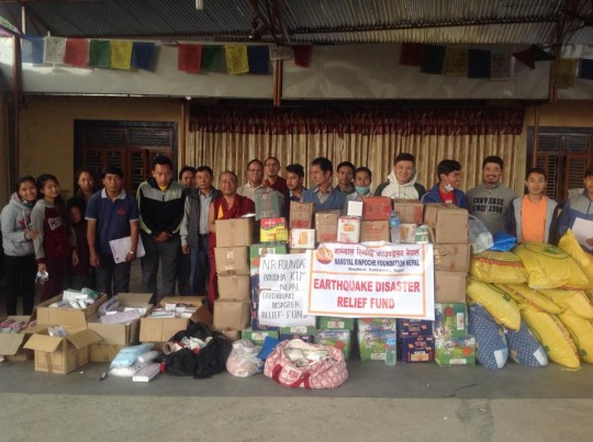 Losang Namgyal Rinpoche with workers from the Namgyal Foundation and aid to be delivered to Tamang communities, Kathmandu, Nepal