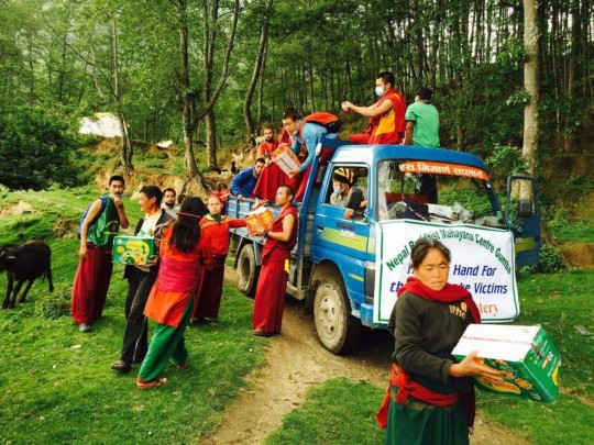 Kopan monks delivering aid