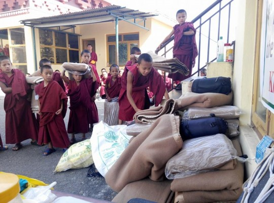 Young Kopan monks donating blankets to earthquake victims, Nepal, May 1