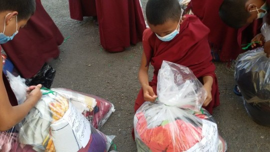 Young monks helping to prepare emergency relief, Kopan Monastery, Nepal, May 2, 2015. Photo courtesy Kopan Monastery School on Facebook.
