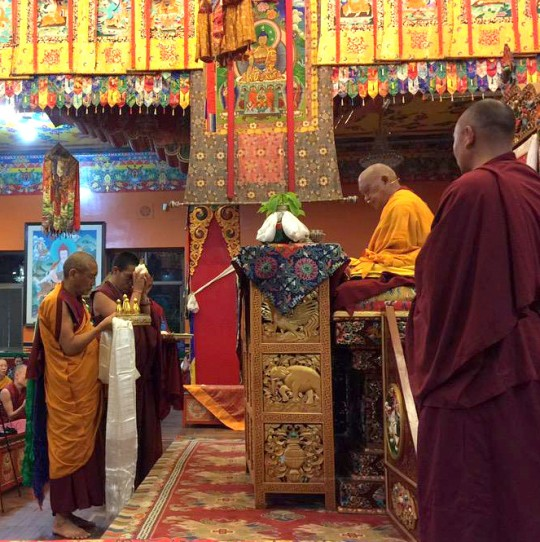 Khen Rinpoche Geshe Chonyi offering the mandala to Lama Zopa Rinpoche at the beginning of the Most Secret Hayagriva initiation, Kopan Monastery, Nepal, May 2, 2015.