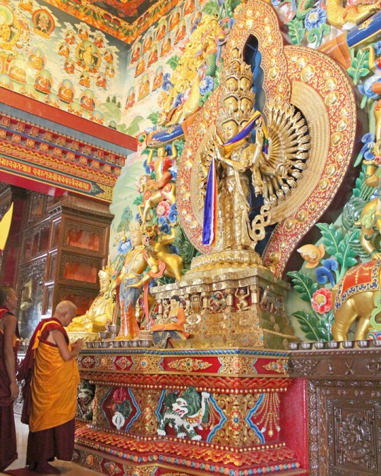 Lama Zopa Rinpoche in front of a thousand armed Chenrezig statue, which is the main statue in the new gompa at Kopan Nunnery, Nepal, April 39, 2015. Photo by Ven. Lobsang Sherab.