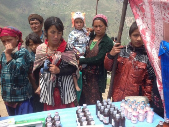 Providing medical aid in Rasuwa District, Nepal, May 2015
