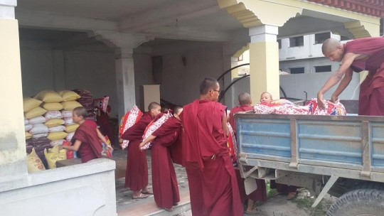 Kopan Monastery nuns loading a truck bound for Rasuwa District, Nepal, May 2015