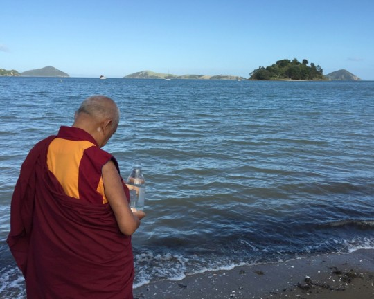 LamaZopaRinpocheblessingthe sentient beings in the ocean before Auckland flight to Nelson, New Zealand, May 2015. Photo by Ven. ThubtenKunsang.