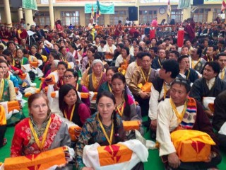 Drolkar McCallum, FPMT North America regional coordinator, waits with others to be part of the procession of offerings during the long life ceremony for His Holiness the Dalai Lama, Dharamsala, India, June 21, 2015