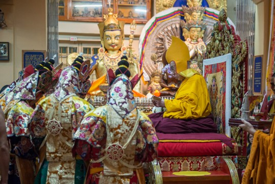 Monks dressed in ritual costumes during the long life puja ceremony for His Holiness the Dalai Lama at the Main Tibetan Temple in Dharamsala, HP, India on June 21, 2015. Photo/Tenzin Choejor/OHHDL
