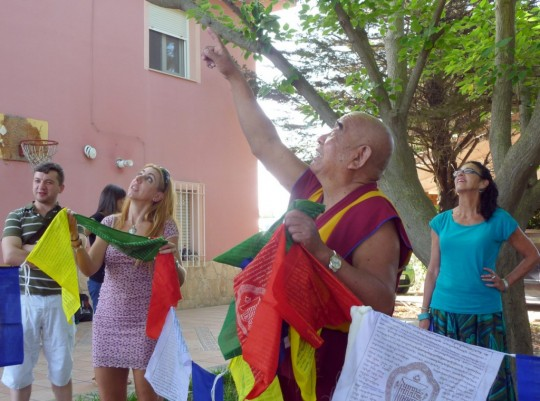 Hanging prayer flags with Geshe Lamsang at Centro Nagarjuna Valencia, Spain, July 2015. Photo courtesy of center.